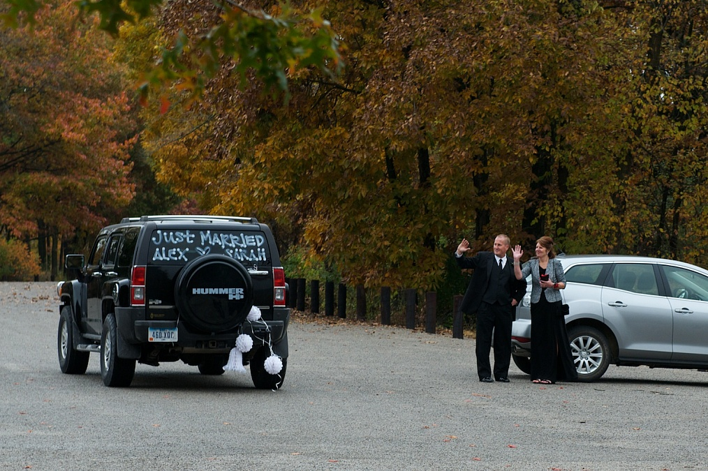 The couple departs after their wedding ceremony at F.W. Kent Park in Johnson County, Iowa.