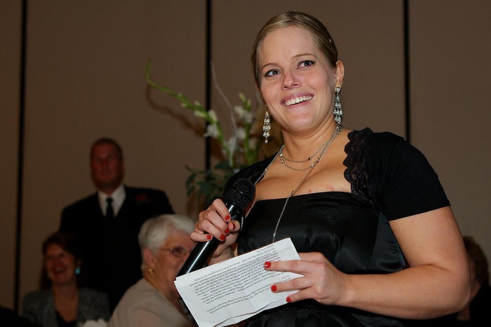 Toasts at Sarah and Alex's wedding reception held at Bella Sala in Tiffin, Iowa.
