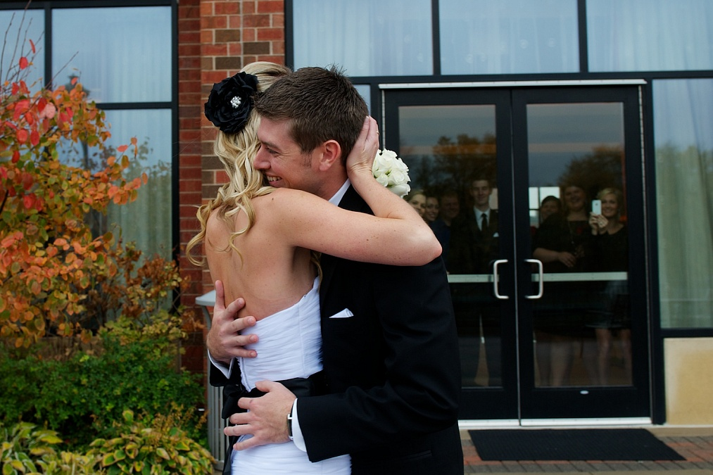 The couple shares their first look of each other on their wedding day at the Marriott in Coralvile.