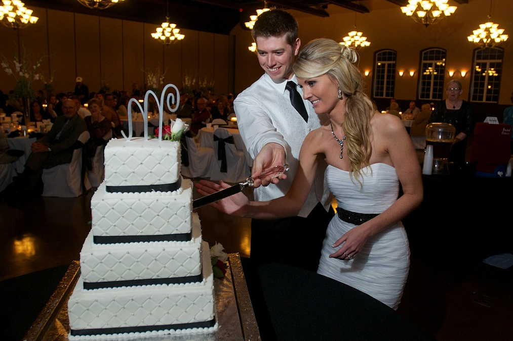Cutting the wedding cake at Bella Sala in Tiffin, Iowa.