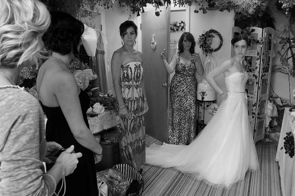 The bridal party prepares for Meagan's wedding at the Gardens at Gazebo on the Green in Iowa City, Iowa.